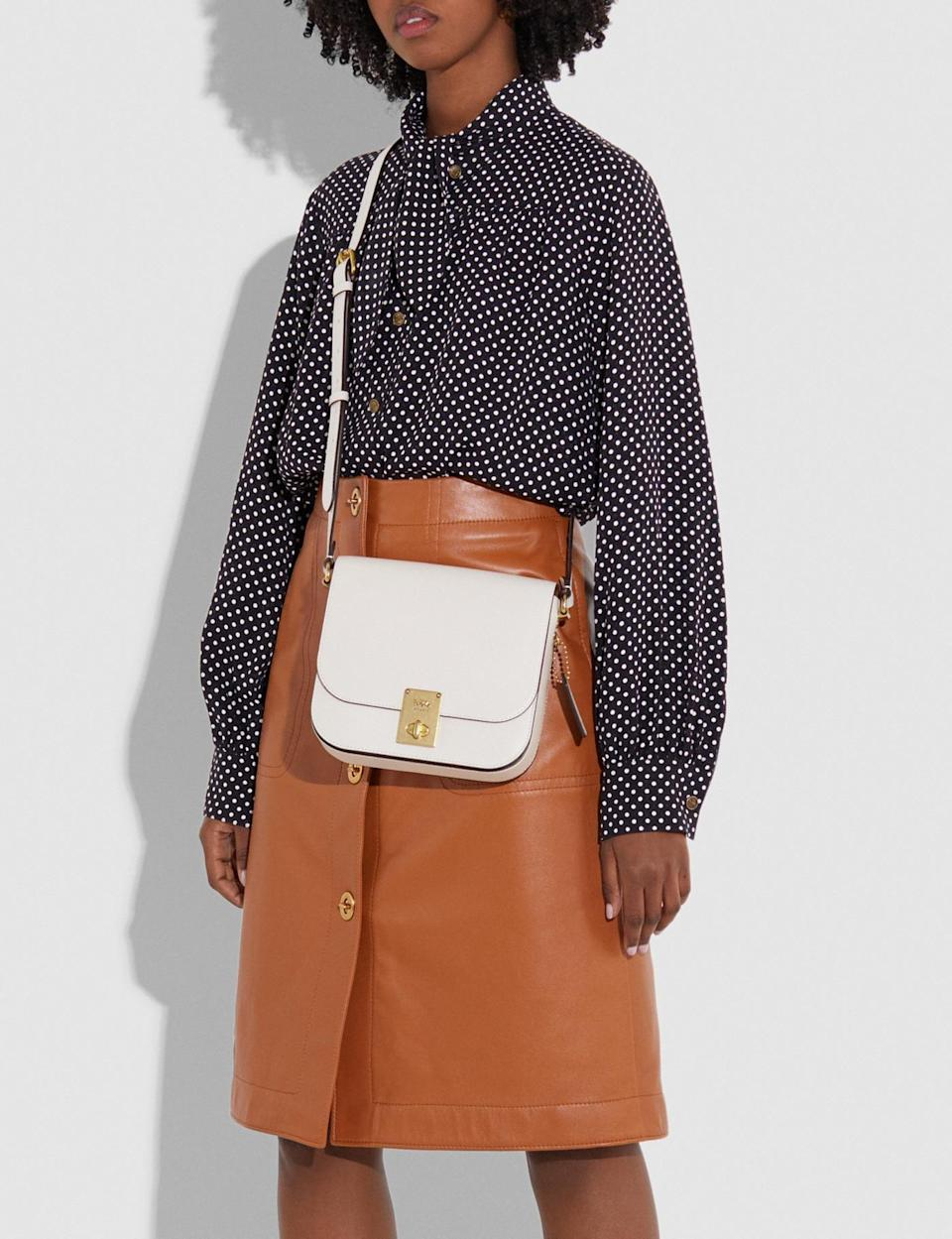 <p>This classic <span>Coach Hutton Saddle Bag</span> ($350) is easy to carry and also comes in black.</p>