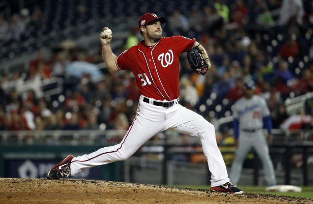 Washington Nationals starting pitcher Max Scherzer throws during the third inning of the second baseball game of a doubleheader against the Los Angeles Dodgers at Nationals Park, Saturday, May 19, 2018, in Washington. (AP Photo/Alex Brandon)