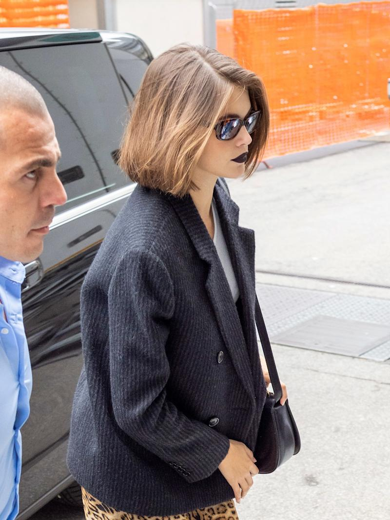 Kaia Gerber Takes Max Mara's Moody Lip to the Streets of Milan