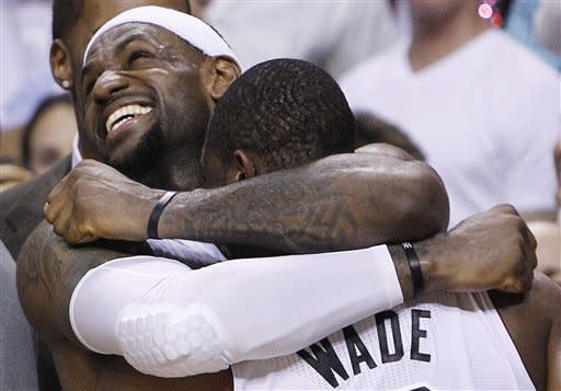 Miami Heat small forward LeBron James (6) and shooting guard Dwyane Wade react in the final moments during the second half at  Game 5 of the NBA finals basketball series, Thursday, June 21, 2012, in Miami. The Heat won 121-106 to become the 2012 NBA Champions.(AP Photo/Lynne Sladky)