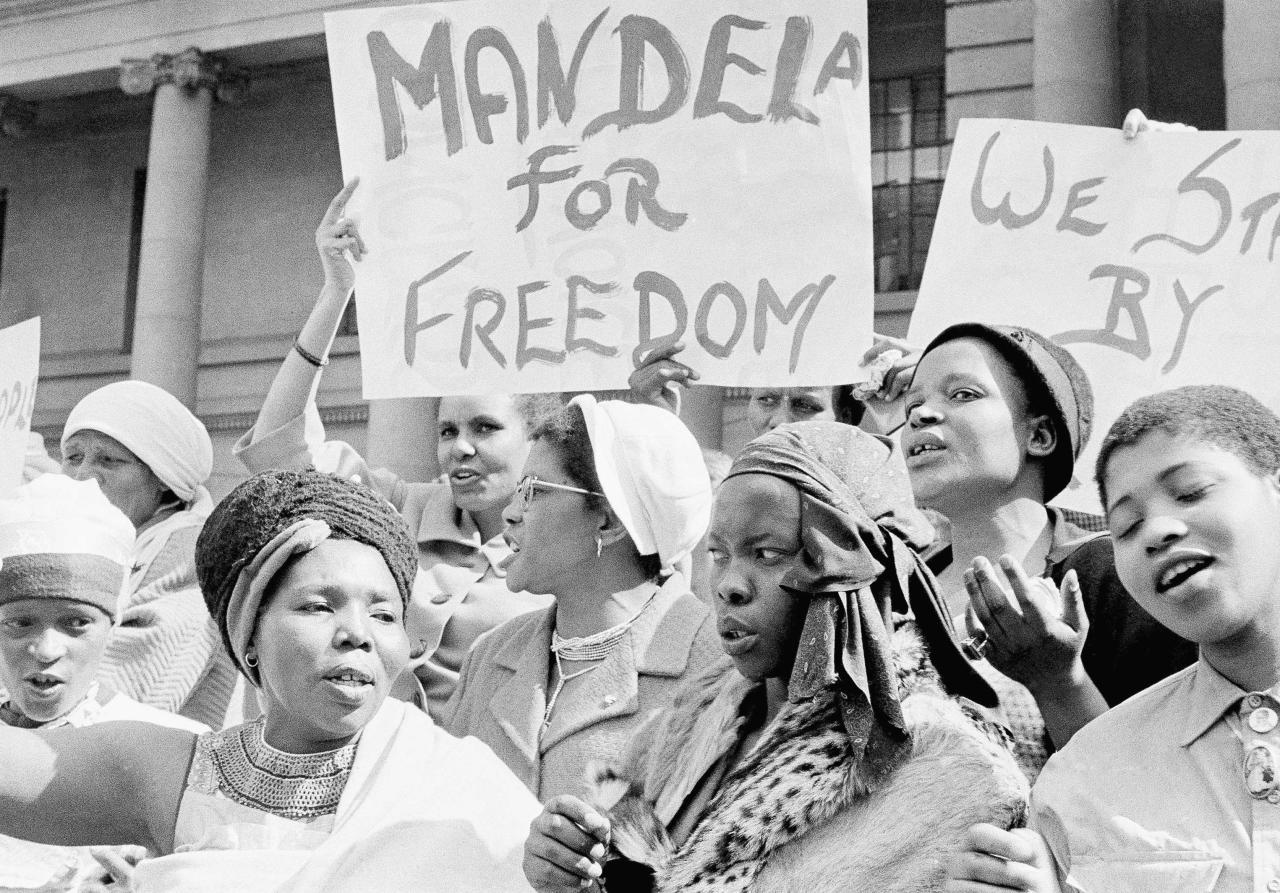 "<p>African women join in a demonstration in South Africa, Aug. 16, 1962, demanding the release of Nelson Mandela, former secretary of the banned African National Congress, who appeared in court on a charge of incitement. The women, together with Winnie Mandela, chanted ""Down with Verwoerd"" on the steps of the Johannesburg City Hall. (Photo: Dennis Lee Royle/AP) </p>"