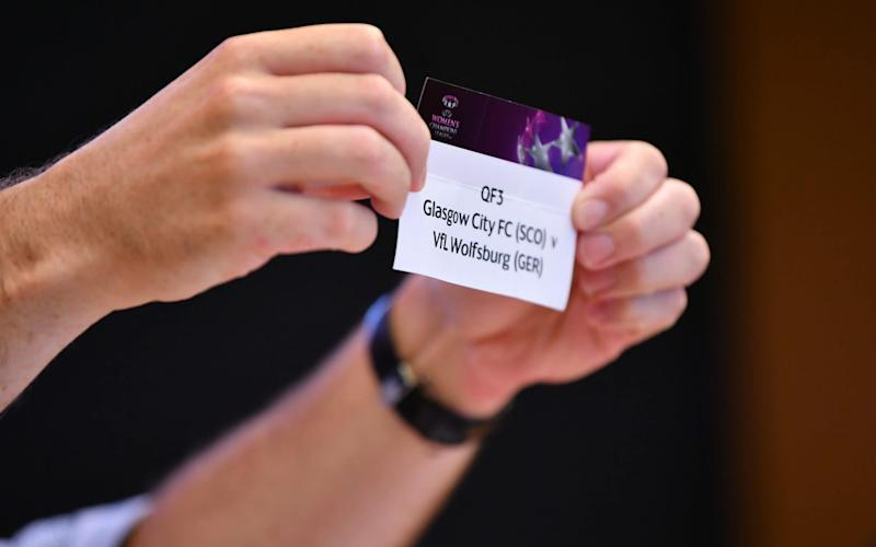 The card of QF3 Glasgow City FC v VfL Wolfsburg is drawn out during the UEFA Women's Champions League - Getty Images