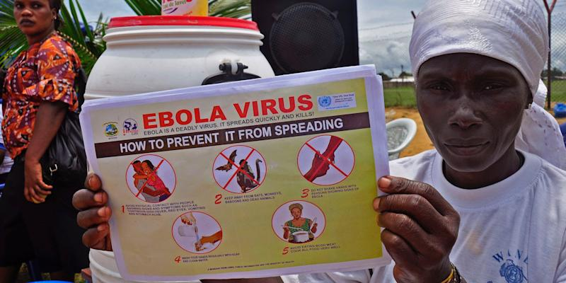 A Liberian woman holds up a pamphlet with guidance on how to prevent the Ebola virus from spreading, in the city of Monrovia, Liberia, Thursday, Aug. 14, 2014.