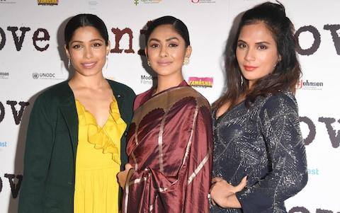 Freida Pinto with Love Sonia co-stars Mrunal Thakur and Richa Chadha at the UK Premiere  - Credit: Getty