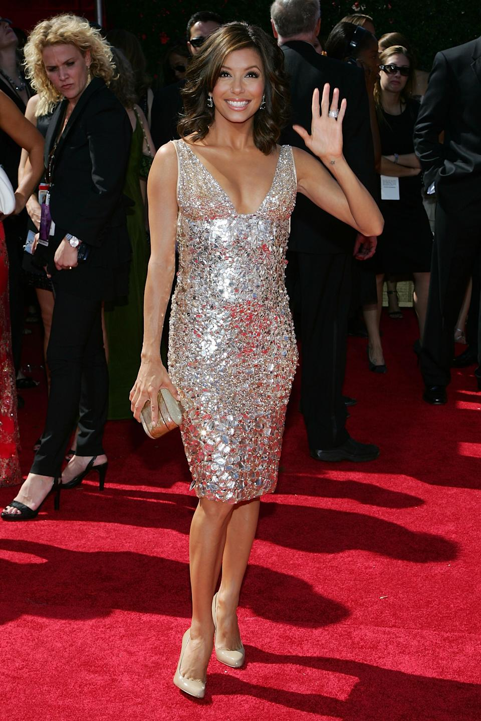 """<p>In 2007, """"Desperate Housewives"""" star, Eva Longoria, bucked the trend of donning a gown in favour of a knee-length sparkling look by Kaufman Franco (Image via Getty Images)</p>"""