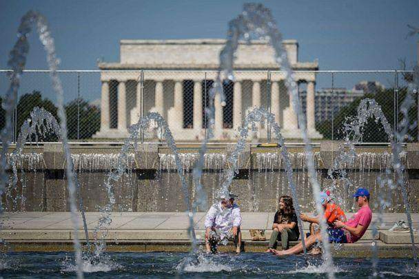PHOTO: People cool off in the fountains at the World War II Memorial on the National Mall, June 29, 2021, in Washington, D.C. (Drew Angerer/Getty Images)