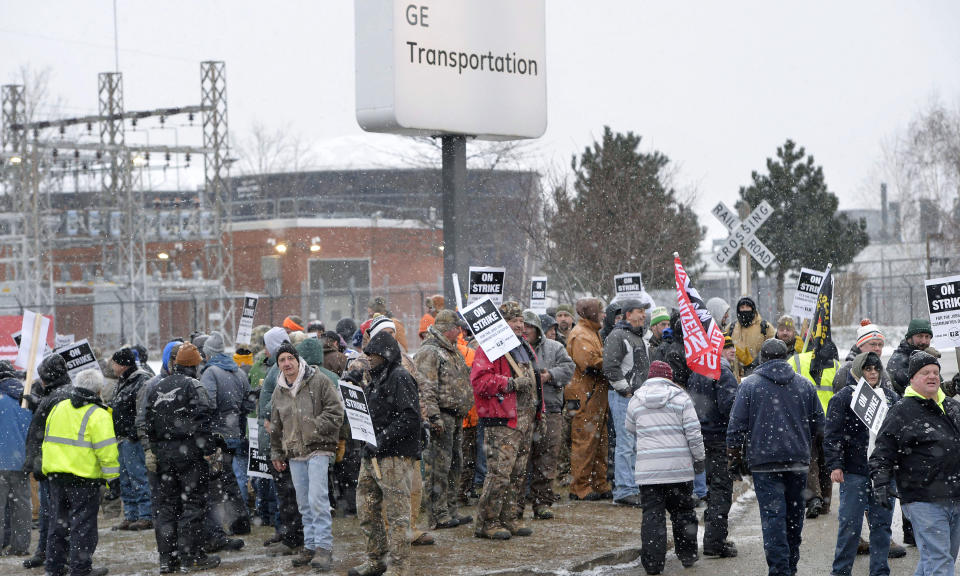 Wabtec Corp. employees, who are members of UE Local 506, strike near the west gate of the former GE Transportation plant in Lawrence Park Township, Erie County, Pa., on Tuesday, Feb. 26, 2019. The merger between GE Transportation and Wabtec Corp., also known as Westinghouse Air Brake Technology Corp., based in Wilmerding, Allegheny County, Pa., was finalized on Feb. 25 but a labor agreement was not reached between Wabtech and several unions, including more than 1,000 UE Local 506 members in Erie. (Greg Wohlford/Erie Times-News via AP)