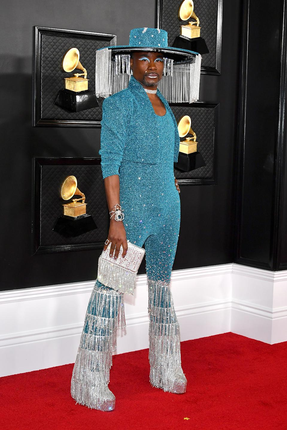 """The """"Pose"""" star and red carpet stand-out upped the ante on the Grammy red carpet with a bold leisure suit, jacket and handbag by Baja East."""