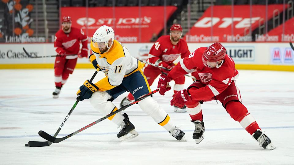 Nashville Predators defenseman Ben Harpur (17) protects the puck from Detroit Red Wings left wing Darren Helm (43) in the second period at Little Caesars Arena in Detroit on Thursday, April 8, 2021.