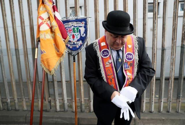 Bandsmen and Orange Order members gather ahead of a parade in Belfast, as part of the annual Twelfth of July celebrations