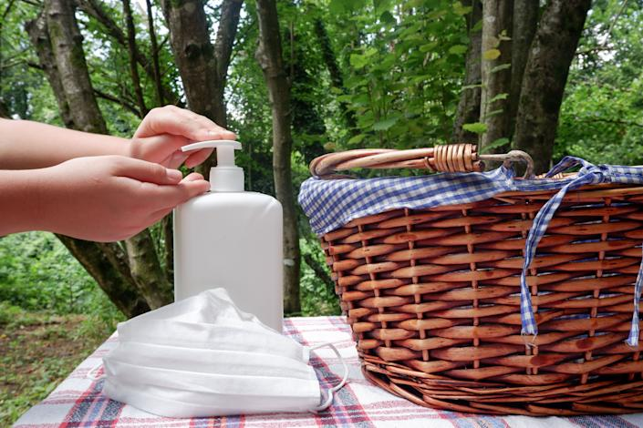 Make sure to sanitize hands and surfaces before eating at your picnic location. (Photo: Poseidon_v via Getty Images)