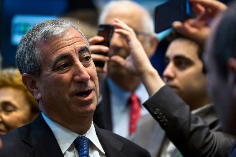 Chief executive officer of Moelis & Co., Ken Moelis smiles after ringing the bell to mark the company's IPO on the floor of the New York Stock Exchange shortly after the opening bell in New York