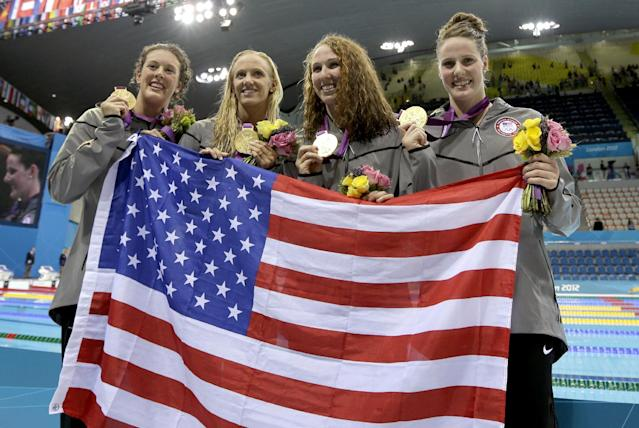 From right, United States' Missy Franklin, United States' Dana Vollmer, United States' Shannon Vreeland and United States' Allison Schmitt pose with their gold medals for the women's 4x200-meter freestyle relay swimming final at the Aquatics Centre in the Olympic Park during the 2012 Summer Olympics in London, Wednesday, Aug. 1, 2012. (AP Photo/Matt Slocum)