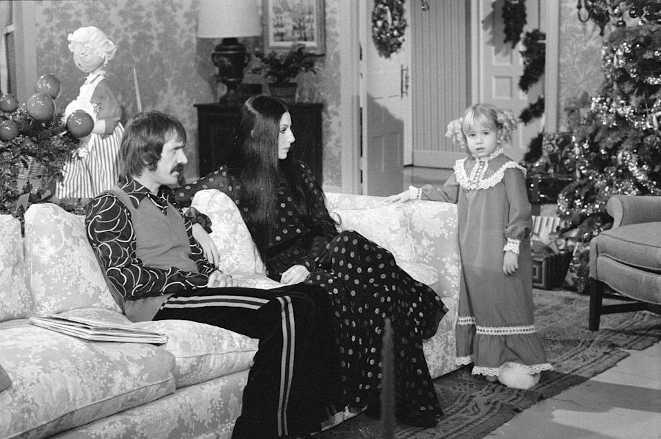 "<p>While recording a Christmas special for their show, <em>The Sonny and Cher Comedy Hour</em>, Sonny Bono stood out in a vibrant printed button-down, striped slacks and a sweater vest. </p><p><strong>RELATED:</strong> <a href=""https://www.goodhousekeeping.com/life/entertainment/a34860345/cher-2020-new-movie-elephant-sonny-interview/"" rel=""nofollow noopener"" target=""_blank"" data-ylk=""slk:How Cher Made the Most Out of Her 2020"" class=""link rapid-noclick-resp"">How Cher Made the Most Out of Her 2020</a></p>"