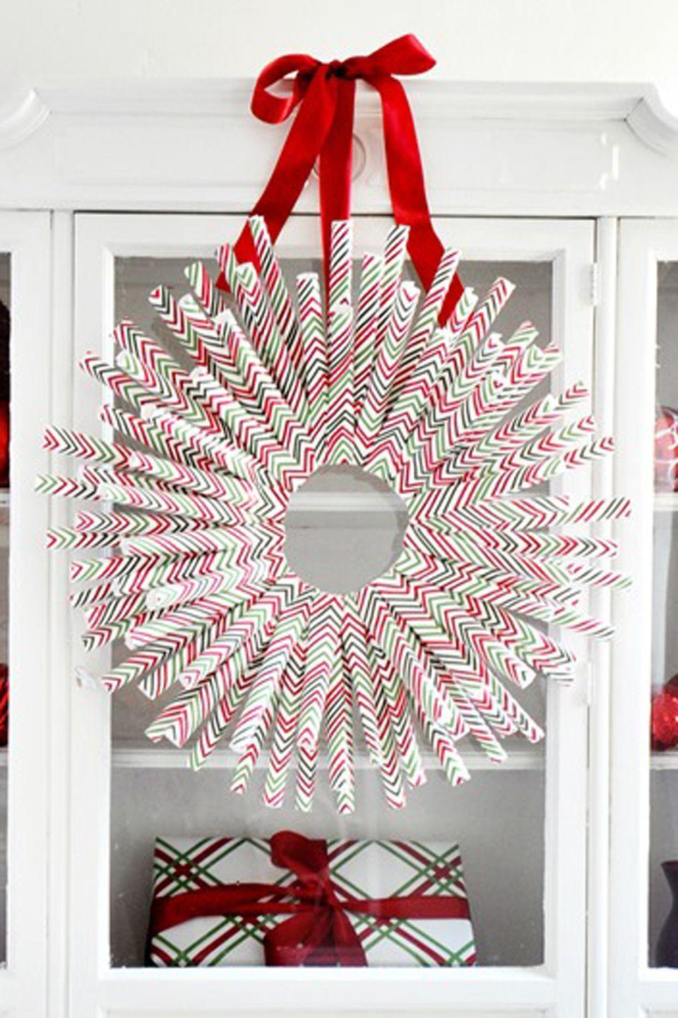 """<p>You know you've just finished your gift wrapping when you're staring at a mile-high pile of wrapping paper odds and ends. Combine them all into the most creative wreath on the block. </p><p><a href=""""http://centsationalgirl.com/2013/11/diy-wrapping-paper-wreath/"""" rel=""""nofollow noopener"""" target=""""_blank"""" data-ylk=""""slk:Get the tutorial at Centsational Girl »"""" class=""""link rapid-noclick-resp""""><em>Get the tutorial at Centsational Girl »</em></a></p>"""
