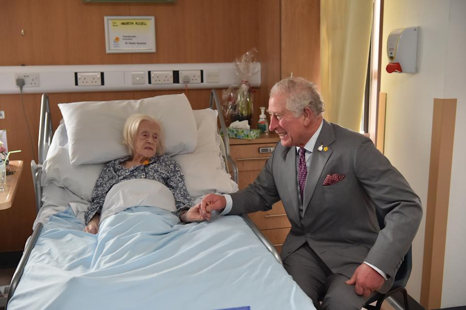 The Prince of Wales meeting patient Maureen Russell, 97, during a visit to the Marie Curie Hospice in Cardiff and the Vale, Wales.