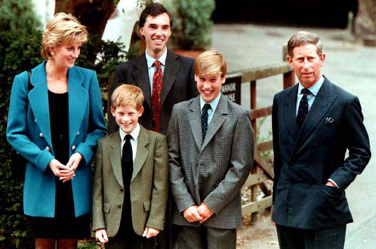 The Prince and Princess of Wales, Prince Harry, and housemaster Dr Andrew Gayley (behind) escort Prince William (2R), second in line to the throne, for his first day of term at the world famous Eton College September 6, 1995. REUTERS/Simon Kreitem