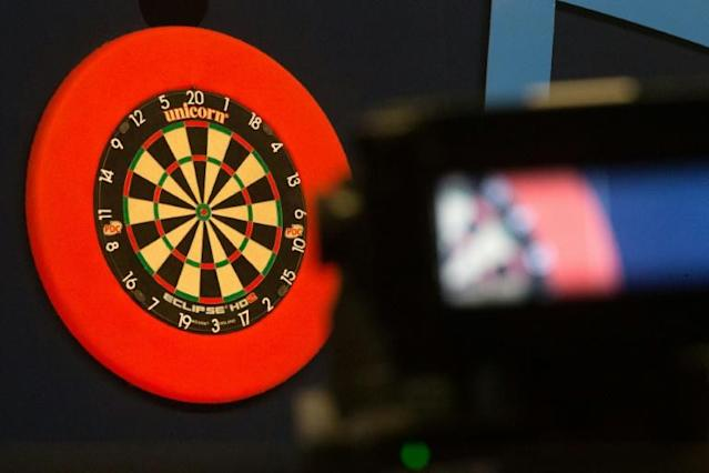 Fallon Sherrock was finally beaten at the world darts championship on Friday after becoming the first woman to win a match at the tournament (AFP Photo/DANIEL LEAL-OLIVAS)