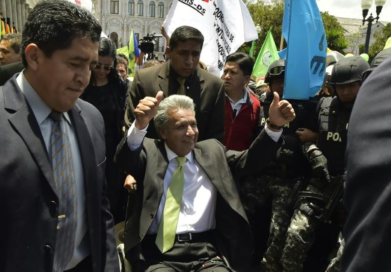Ecuador's President-elect Lenin Moreno (C) greets supporters at the Plaza Grande in Quito on April 3, 2017