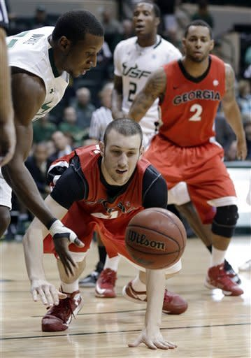 Georgia center John Cannon, center, and South Florida forward Kore White, left, chase a loose ball during the first half of an NCAA college basketball game Friday, Nov. 30, 2012, in Tampa, Fla. (AP Photo/Chris O'Meara)