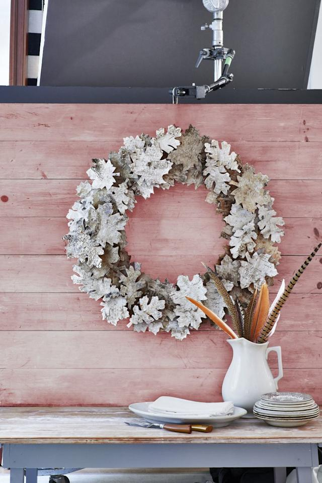"""<p>Create an eye-catching wreath for your wall or front door. Trace leaf cookie cutters on the backs of <a href=""""https://www.etsy.com/listing/714450437/birch-bark-sheets-ten-sheets"""" target=""""_blank"""">birch bark strips</a>, then use an <a href=""""https://www.amazon.com/X-ACTO-2-Knife-Safety-Cap/dp/B000V1QV7O/"""" target=""""_blank"""">X-Acto knife</a> to cut out. (You'll need about 75 total.) Hot glue half the birch leaves around a <a href=""""http://www.lofloristsupplies.com/20x2-styrofoam-wreath/"""" target=""""_blank"""">20"""" foam wreath form</a>. Hot glue <a href=""""https://www.amazon.com/Craftwood-Wooden-Cubes-36-Pkg-Natural/dp/B007F0UQR0/ref=asc_df_B007F0UQR0/"""" target=""""_blank"""">5/8"""" wooden cubes</a> on the backs of the remaining leaves, then layer them onto the wreath to create a 3-D display.</p>"""