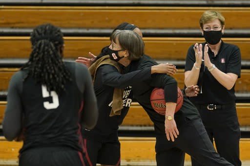 Stanford coach Tara VanDerveer receives congratulations from guard Kiana Williams after defeating Pacific 104-61 in NCAA college basketball game in Stockton , Calif., Tuesday, Dec. 15, 2020. With the win VanDerveer become the winningest coach in women's basketball history passing the late Pat Summitt with her 1,099 victory. (AP Photo/Rich Pedroncelli)