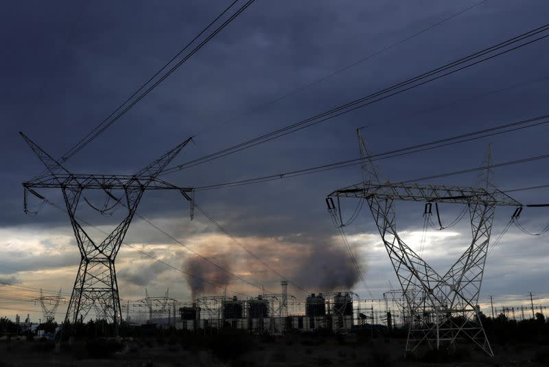 A steady stream of smoke spews out from the five exhaust chimneys belonging to the Tula power plant run by state-owned power company Commission Federal de Electricidad, or CFE, in Tula de Allende