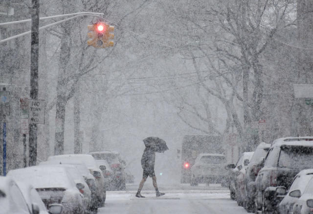 <p>A man crosses the street in heavy snow in Hoboken, N.J., March 7, 2018. (Photo: Seth Wenig/AP) </p>