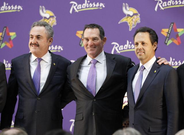 New Minnesota Vikings head coach Mike Zimmer, center, poses with team owner Zygi Wilf, left, and Mark Wilf, right, during an NFL football media availability at Winter Park in Eden Prairie, Minn., Friday, Jan. 17, 2014. Zimmer is the ninth head coach in the Vikings' franchise history.(AP Photo/Ann Heisenfelt)