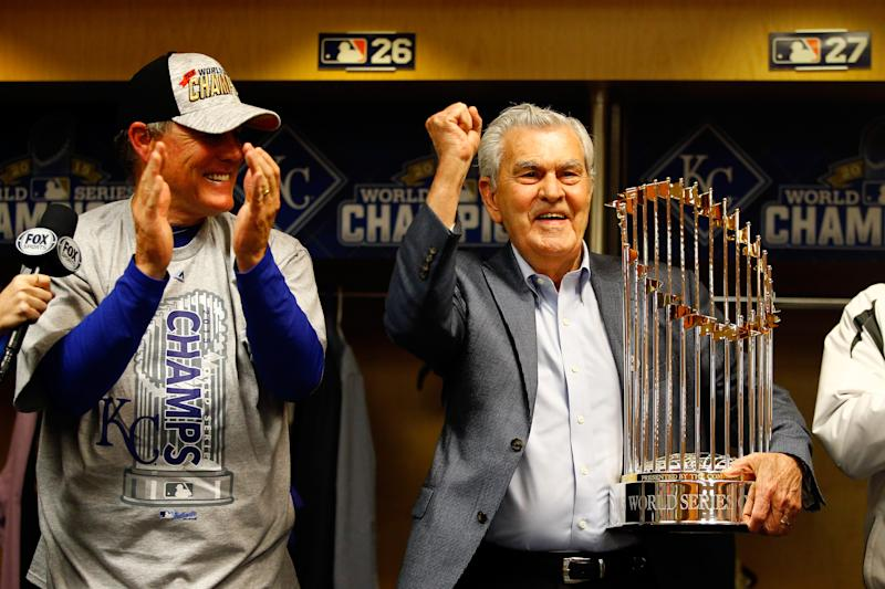 Kansas City Royals owner David D. Glass, right, holds the Commissioner's Trophy after the Royals beat the New York Mets in the 2015 World Seires. (Photo by Al Bello/Getty Images)