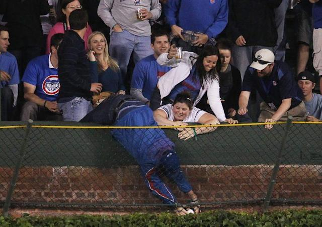 A fan grabs a ball from the Wrigley Field basket in a 2011 game. (Getty Images)
