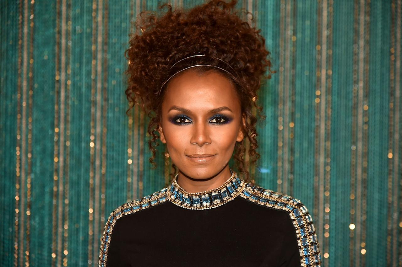 <p>The writer and TV host wore this beautiful naturally curly updo to the 2017 Brooklyn Artists Ball. A gold headband and tea smoky eye round out this regal beauty look. (Photo: Getty Images) </p>
