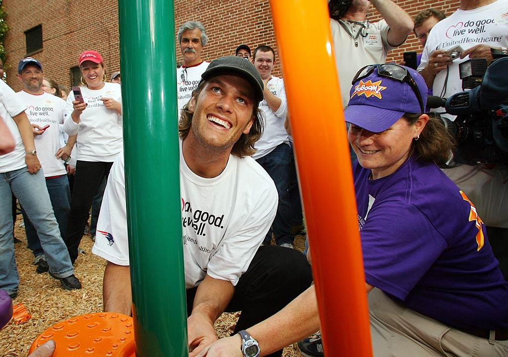 """Football star Tom Brady and several of his teammates hit the playground for a good cause Tuesday when they helped build play equipment at the Waltham Boys & Girls Club in Massachusetts. The 2,130-square-foot park was a collaboration between the Boys & Girls Club, the Patriots, United Healthcare, and Kaboom, a nonprofit that has helped build more than 1,800 playgrounds across the United States. Gail Oskin/<a href=""""http://www.wireimage.com"""" target=""""new"""">WireImage.com</a> - October 26, 2010"""
