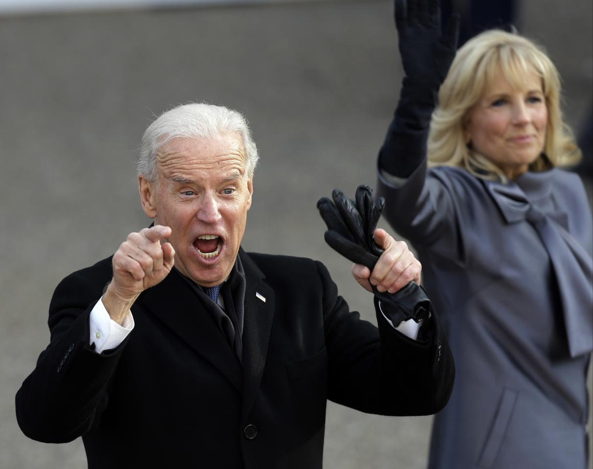 Vice President Joe Biden reacts with his wife, Jill, as they walk down Pennsylvania Avenue en route to the White House, Monday, Jan. 21, 2013, in Washington. Thousands marched during the 57th Presidential Inauguration parade after the ceremonial swearing-in of President Barack Obama. (AP Photo/Gerald Herbert)