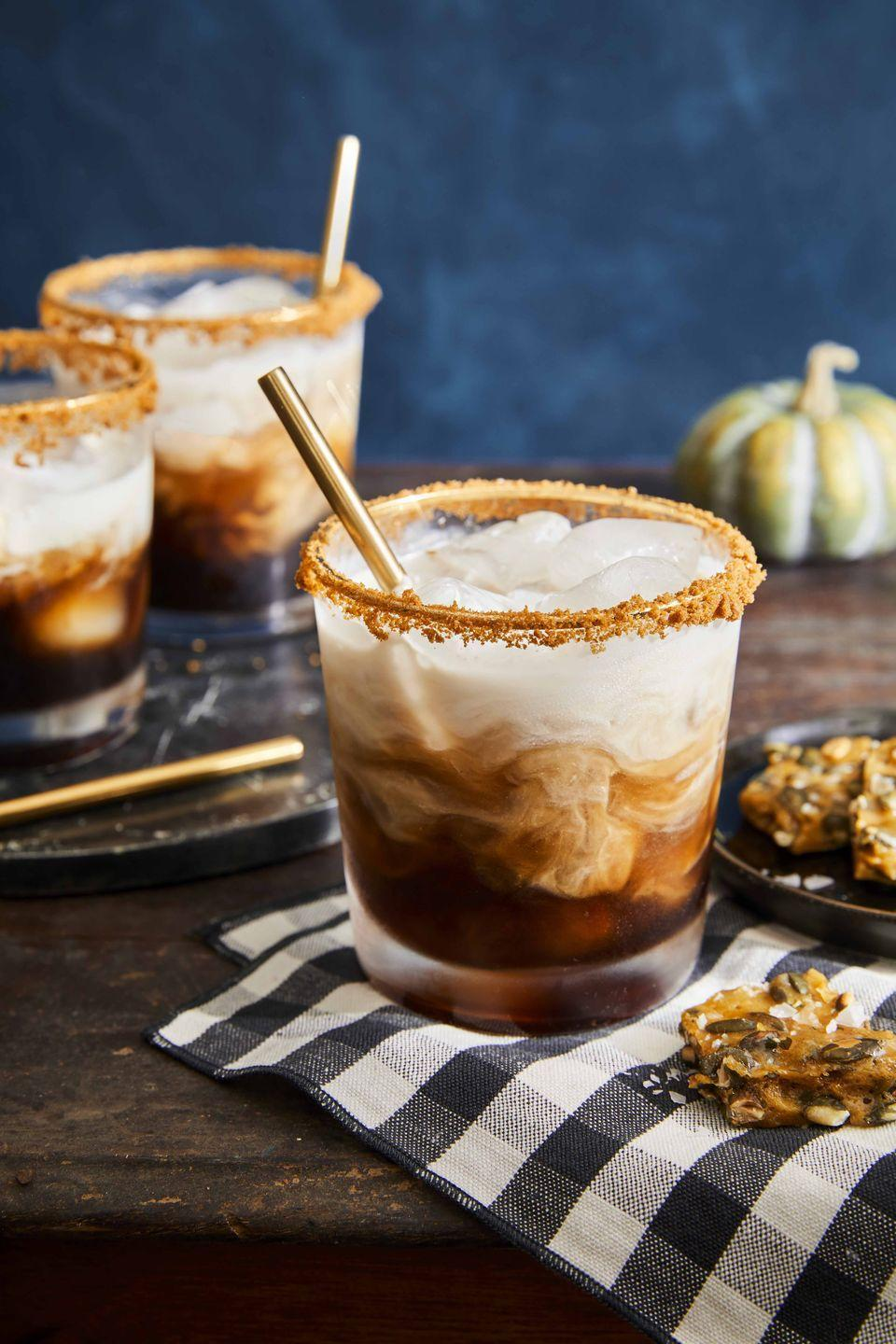 """<p>Greet guests with a drink that carries a touch of the season—and lets everyone relax while you put the finishing touches on dinner.</p><p><strong><a href=""""https://www.countryliving.com/food-drinks/a33944101/pumpkin-spice-white-russian/"""" rel=""""nofollow noopener"""" target=""""_blank"""" data-ylk=""""slk:Get the recipe"""" class=""""link rapid-noclick-resp"""">Get the recipe</a>.</strong> </p>"""
