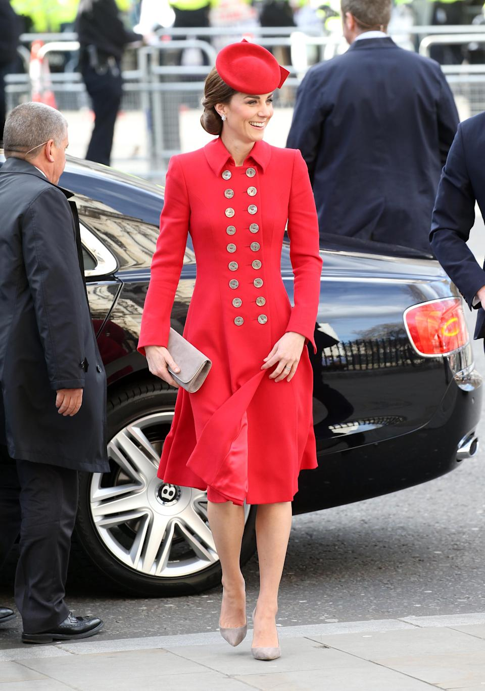 For the Commonwealth Day service, Kate wore a repeat red Catherine Walker coat dress (from the New Zealand tour in 2014) with a matching hat and grey suede pumps and clutch from Emmy London. [Photo: Getty]