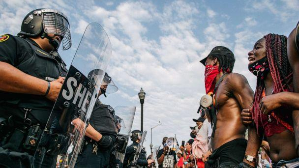 PHOTO: Demonstrators participate in a form a line in front of law enforcement on Aug. 24, 2020 in Kenosha, Wisc. (Brandon Bell/Getty Images)