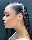 """One look at these <a href=""""https://www.glamour.com/story/knotless-braids-guide?mbid=synd_yahoo_rss"""" rel=""""nofollow noopener"""" target=""""_blank"""" data-ylk=""""slk:knotless box braids"""" class=""""link rapid-noclick-resp"""">knotless box braids</a>, and it's not hard to see why the technique has blown up over the past few years. Because braiders start with your natural hair (instead of adding extensions at the root), it doesn't create as much tension at your scalp—meaning it's more comfortable with less chance of breakage. There's also an added sleekness thanks to the knot-fee style, which creates a seamless look."""