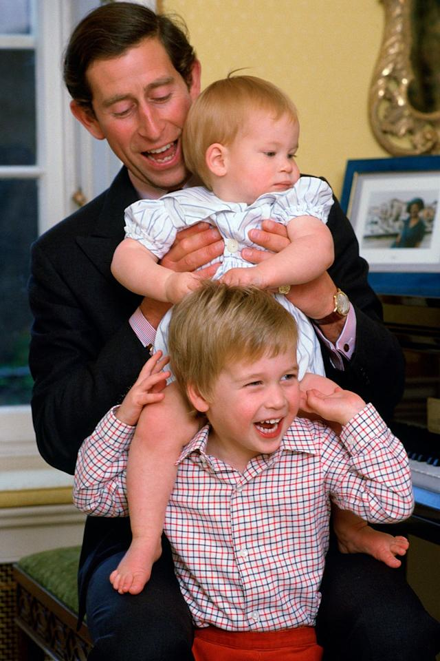 """<p>Here, the little prince cheeses with a one-year-old Harry on his shoulders. Although the two aren't exactly spitting images of each other today, William's blonde hair and gingham shirt give off major <a href=""""https://www.marieclaire.com/celebrity/a20771447/prince-george-official-royal-wedding-portrait/"""" target=""""_blank"""">Prince George</a> vibes.</p>"""