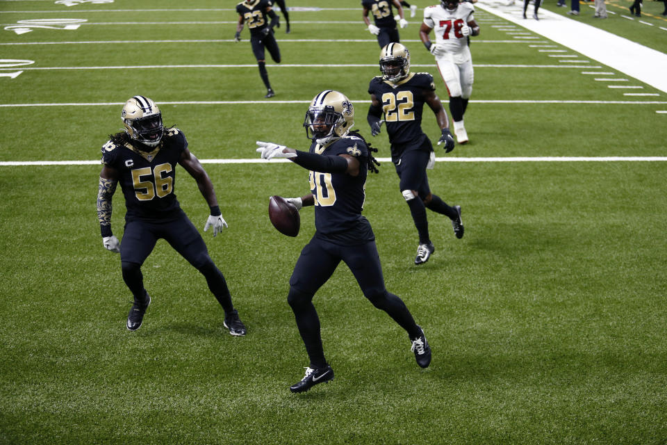 New Orleans Saints cornerback Janoris Jenkins (20) celebrates his pick six with outside linebacker Demario Davis (56) and safety Chauncey Gardner-Johnson (22) in the second half of an NFL football game against the Tampa Bay Buccaneers