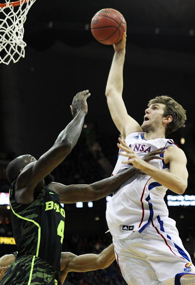 KANSAS CITY, MO - MARCH 09: Jeff Withey #5 of the Kansas Jayhawks goes up for a dunk over Quincy Acy #4 of the Baylor Bears in the second half during the semifinals of the 2012 Big 12 Men's Basketball Tournament at Sprint Center on March 9, 2012 in Kansas City, Missouri. (Photo by Jamie Squire/Getty Images)
