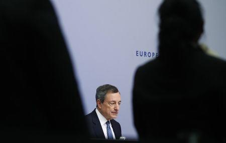Draghi warns of downside risks as European Central Bank ends net asset purchases