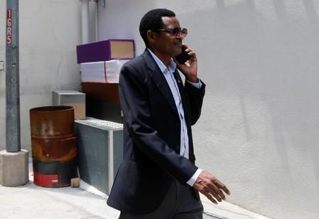 Zimbabwe's charge d'affaires Claudius Nhema arrives at funeral parlour Singapore Casket, following the death of former President Robert Mugabe in Singapore