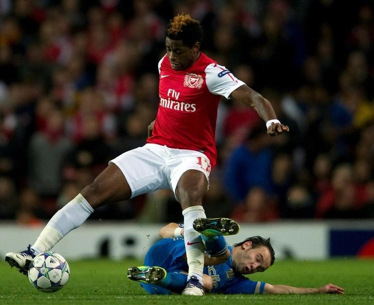 Alex Song (L) playing for Arsenal against Marseille in the 2011/2012 UEFA Champions League.