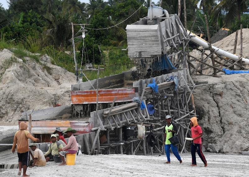 One-third of the world's tin comes from the Indonesian islands of Bangka and Belitung, where thousands risk serious injury and death in the mines (AFP Photo/GOH Chai Hin)