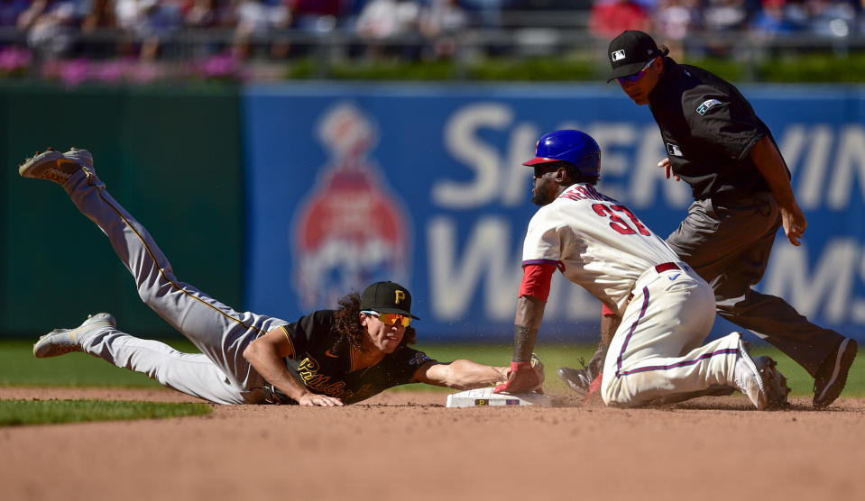 Philadelphia Phillies' Odubel Herrera (37) slides safely into second base for a double past the tag of Pittsburgh Pirates' Cole Tucker, left, during the fifth inning of a baseball game, Sunday, Sept. 26, 2021, in Philadelphia. (AP Photo/Derik Hamilton)