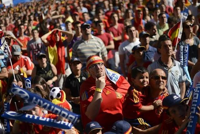 Supporters of the Spanish national football team watch their team during the Euro 2012 Championships football match between Spain and Italy on June 10, 2012 near Santiago Bernabeu Stadium in Madrid. AFP PHOTO/ DANI POZODANI POZO/AFP/GettyImages