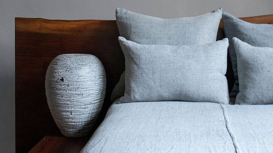 """<p><strong>RW Guild </strong></p><p>rwguild.com</p><p><strong>$750.00</strong></p><p><a href=""""https://rwguild.com/collections/soft-goods/products/rw-guild-enzyme-linen-coverlet-king?variant=32325149917287"""" rel=""""nofollow noopener"""" target=""""_blank"""" data-ylk=""""slk:Shop Now"""" class=""""link rapid-noclick-resp"""">Shop Now</a></p><p>Great neutral bedding for the bedroom.</p>"""