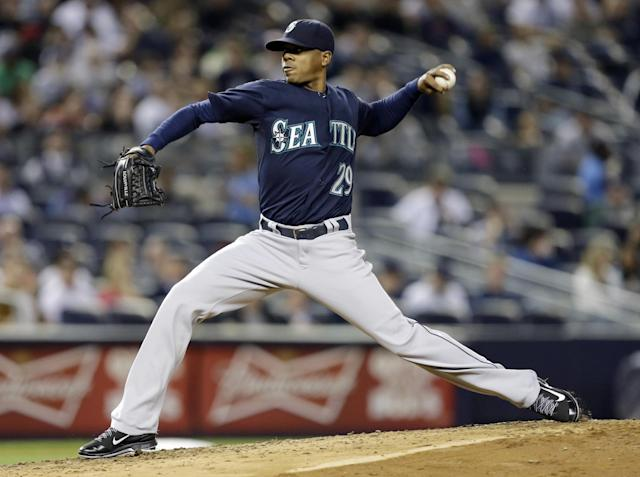 Seattle Mariners' Roenis Elias delivers a pitch during the third inning of a baseball game against the New York Yankees, Thursday, May 1, 2014, in New York. (AP Photo/Frank Franklin II)