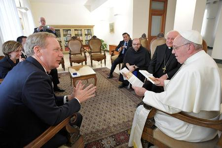 Microsoft President and Chief Legal Officer Brad Smith meets with Pope Francis at Saint Martha's House at the Vatican, February 13, 2019. Vatican Media/Handout via REUTERS